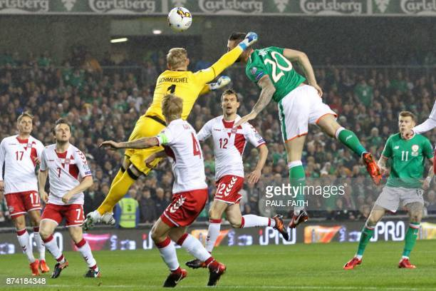 Republic of Ireland's defender Shane Duffy jumps to head the opening goal past Denmark's goalkeeper Kasper Schmeichel during the FIFA World Cup 2018...