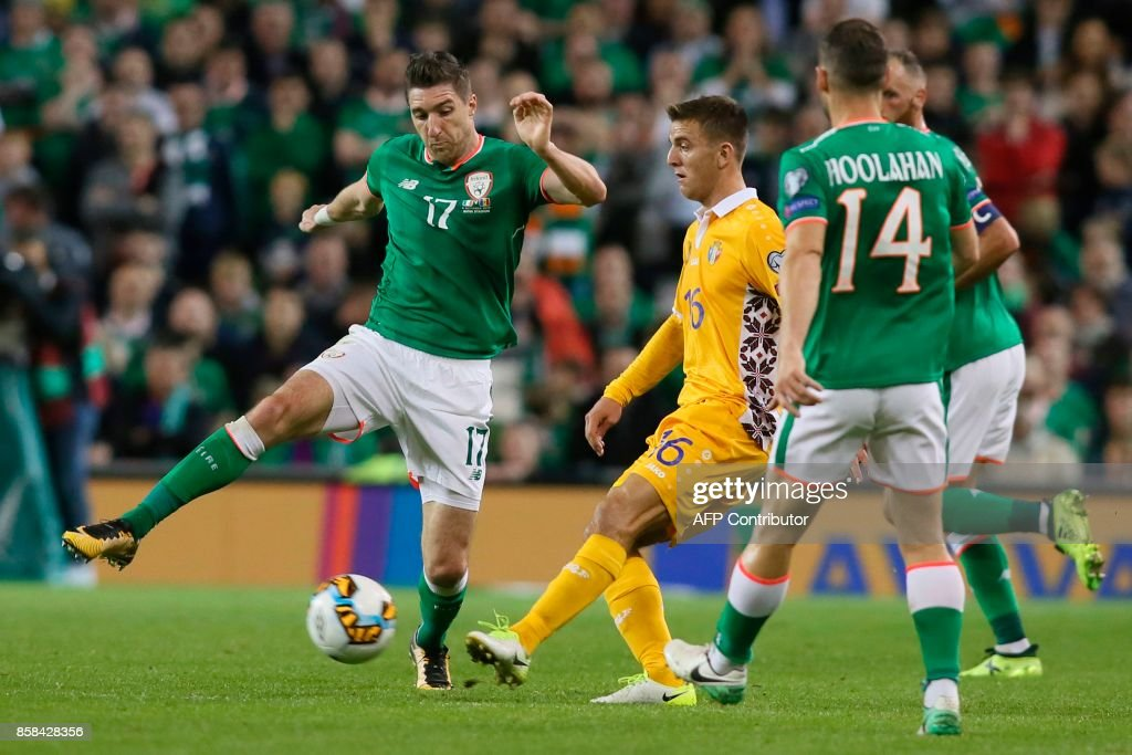 Republic of Ireland's defender Stephen Ward (L) takes on Moldovia's striker Sergiu Platica (C) during the FIFA World Cup 2018 qualification football match between Republic of Ireland and Moldova at the Aviva Stadium in Dublin on October 6, 2017. / AFP PHOTO / Paul FAITH