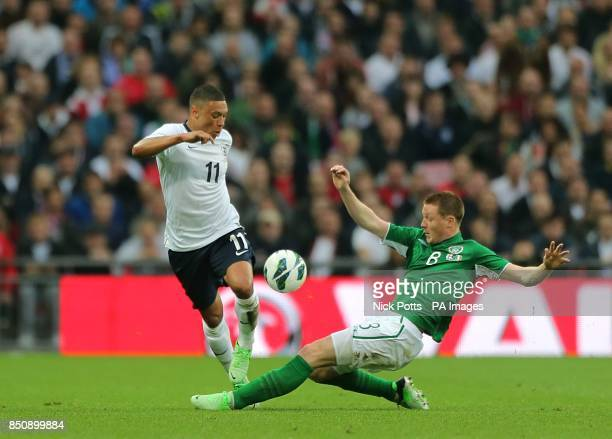 Republic of Ireland's James McCarthy and England's Alex OxladeChamberlain battle for the ball