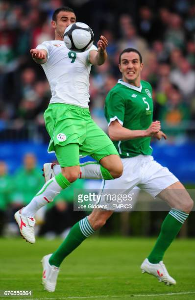 Republic of Ireland's John O'Shea and Algeria's Abdelkader Ghezzal