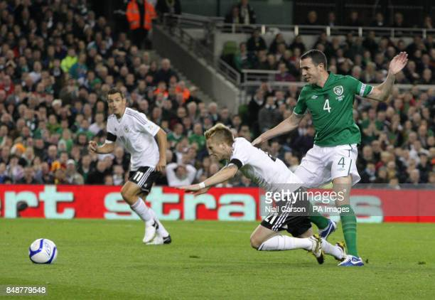 Republic of Ireland's John O'Shea and Germanys Marco Reus battle for the ball during the 2014 FIFA World Cup Qualifying match at the Aviva Stadium...