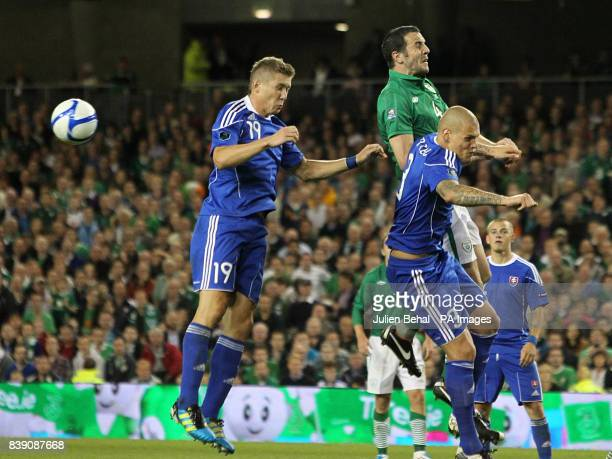 Republic of Ireland's John O'Shea and Slovakia's Juraj Kucka battle for the ball in the air during the European Championship Qualifying match at the...