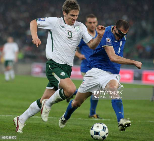 Republic of Ireland's Kevin Doyle is challenged by Italy's Giorgio Chiellini during the World Cup Qualifying match at the Stadio San Nicola Bari Italy