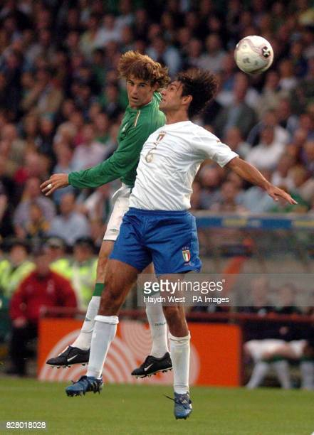 Republic of Ireland's Kevin Kilbane and Italy's Alessandro Nesta jump for the ball