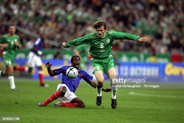 Republic of Ireland's Kevin Kilbane beats Mavuba Antonio of France during their World Cup qualifying Group five match at the Stade de France Paris