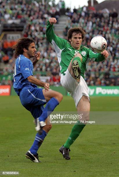 Republic of Ireland's Kevin Kilbane challenges Israel's Saban Klemi