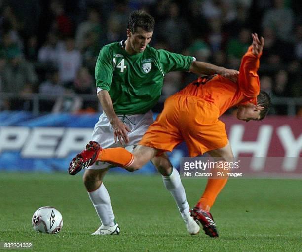 Republic of Ireland's Liam Miller battles with Holland's Klaas Jan Huntelaar during a friendly international at Lansdowne Road in Dublin