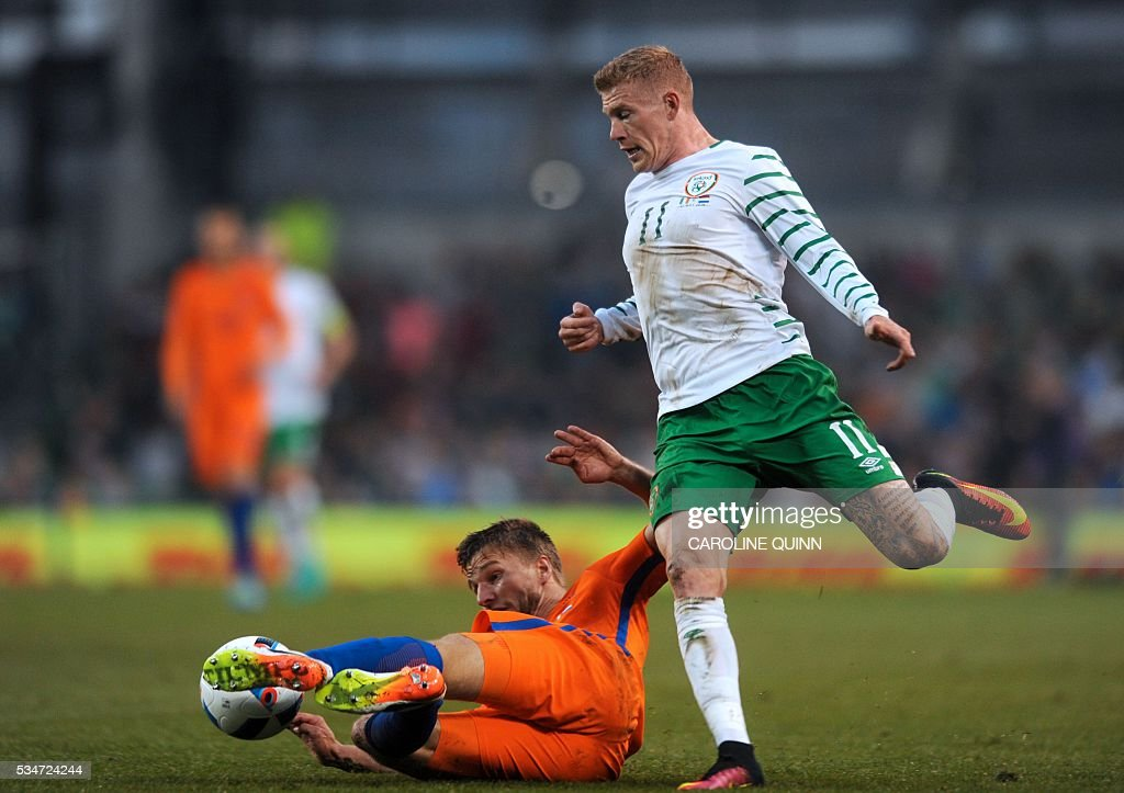 Republic of Ireland's midfielder James McClean (R) vies for the ball against Netherlands' defender Joel Veltman during the friendly football match between Republic of Ireland and the Netherlands at the Aviva Stadium in Dublin, Ireland, on May 27, 2016. / AFP / CAROLINE