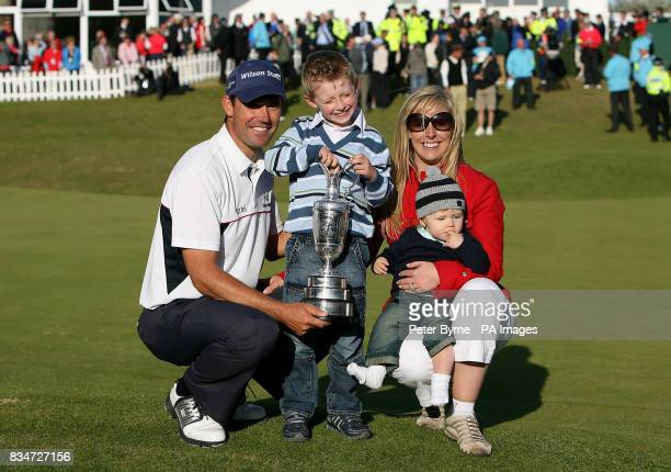 Republic of Ireland's Padraig Harrington son Patrick wife Caroline and son Ciaran celebrates with the trophy after winning the Open Championship at...