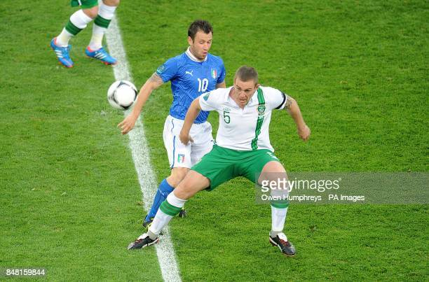 Republic of Ireland's Richard Dunne and Italy's Antonio Cassano battle for the ball