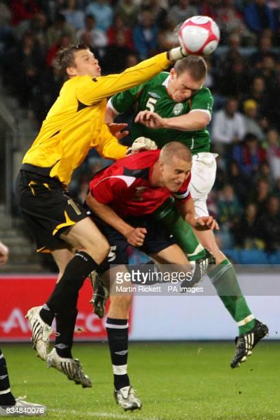 Republic of Ireland's Richard Dunne jumps with Norway's Brede Hangeland and goalkeeper Rune Jarstein