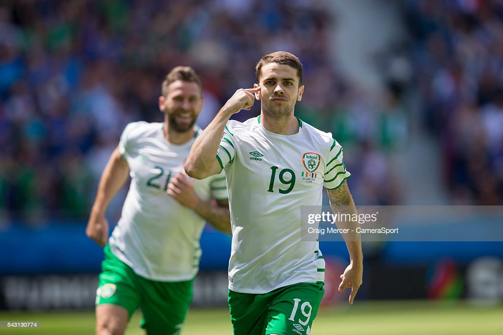 Republic of Ireland's <a gi-track='captionPersonalityLinkClicked' href=/galleries/search?phrase=Robbie+Brady&family=editorial&specificpeople=9028769 ng-click='$event.stopPropagation()'>Robbie Brady</a> (left) celebrates scoring the opening goal from the penalty spot during the UEFA Euro 2016 Round of 16 match between France v Republic of Ireland at Stade de Lyon on June 26 in Lyon, France.