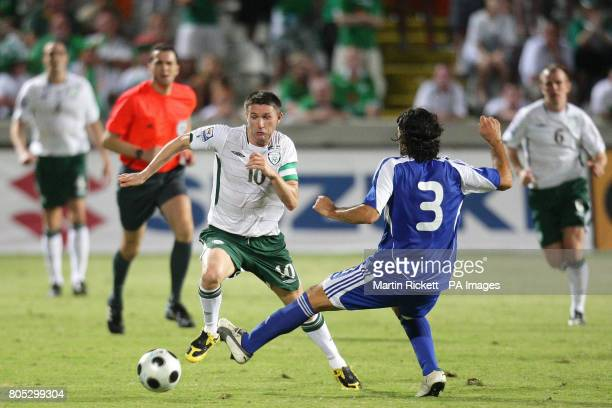 Republic of Ireland's Robbie Keane battles with Cyprus' Elias Charalambous during the World Cup European Qualifying match at the Pancyprian Gymnastic...