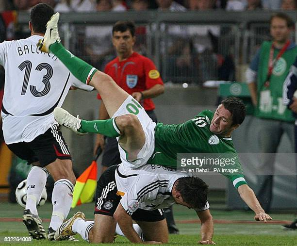 Republic of Ireland's Robbie Keane falls over Germany's Bastian Schweinsteiger during the European Championship qualifying match at the...