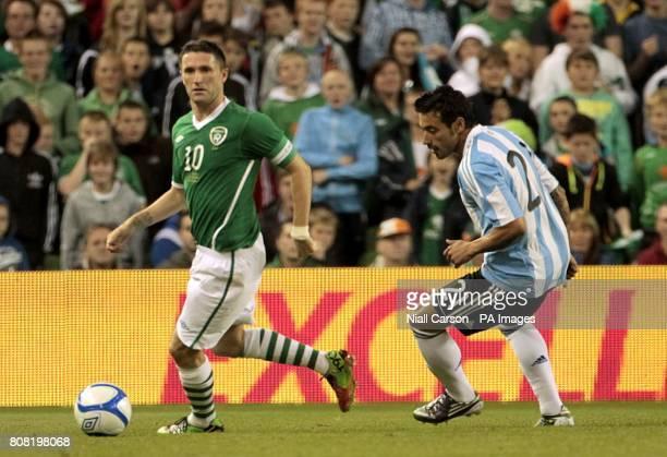 Republic of Ireland's Robbie Keane in action with Argentina's Ezequiel Lavezzi