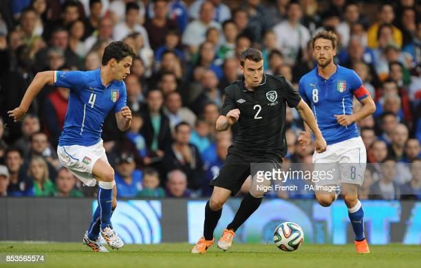 Republic of Ireland's Seamus Coleman and Italy's Mattia De Sciglio battle for the ball during the International Friendly at Craven Cottage London