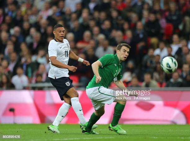 Republic of Ireland's Seamus Coleman attempts to block a shot on goal by England's Alex OxladeChamberlain