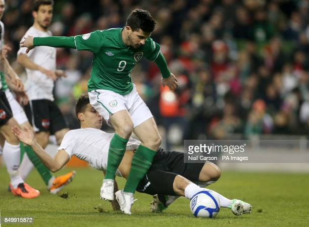 Republic of Ireland's Shane Long and Austria's Aleksander Dragovic in action during the FIFA World Cup Qualifying Group C match at the Aviva Stadium...