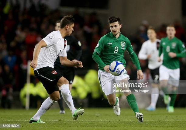 Republic of Ireland's Shane Long in action with Austria's Aleksander Dragovic during the FIFA World Cup Qualifying Group C match at the Aviva Stadium...
