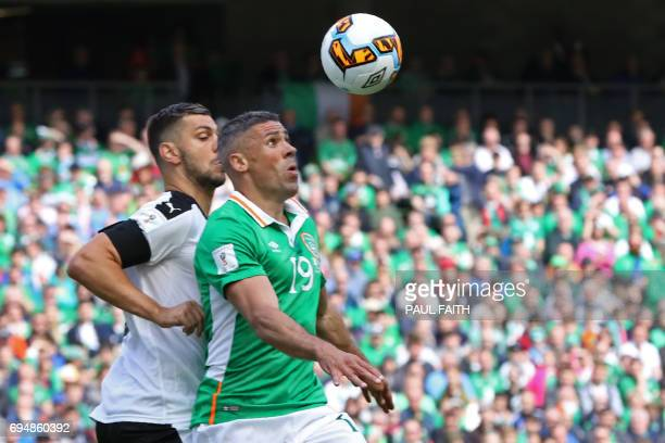 Republic of Ireland's striker Jonathan Walters vies with Austria's defender Aleksandar Dragovic during the group D World Cup qualifying football...