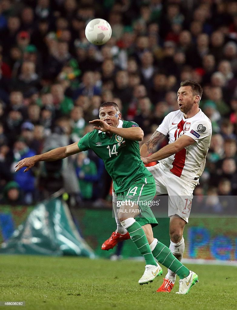 Republic of Ireland's striker <a gi-track='captionPersonalityLinkClicked' href=/galleries/search?phrase=Jonathan+Walters&family=editorial&specificpeople=3389578 ng-click='$event.stopPropagation()'>Jonathan Walters</a> (L) vies with Poland's defender <a gi-track='captionPersonalityLinkClicked' href=/galleries/search?phrase=Jakub+Wawrzyniak&family=editorial&specificpeople=4666843 ng-click='$event.stopPropagation()'>Jakub Wawrzyniak</a> during the Euro 2016 qualifying football match between Republic of Ireland and Poland at Aviva Stadium in Dublin, Ireland on March 29, 2015. The game finished 1-1.