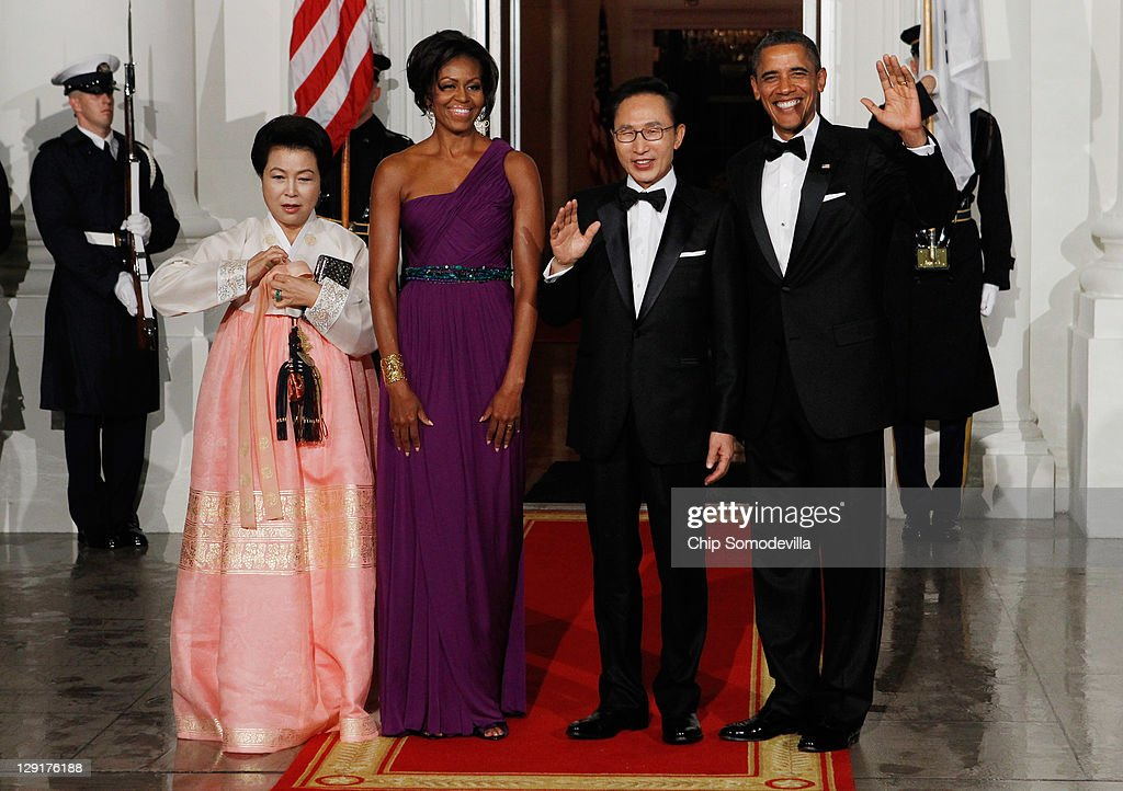 Republic of Korea first lady Kim Yoon-ok, U.S. first lady Michele Obama, South Korean President Lee Myung-bak and U.S. President <a gi-track='captionPersonalityLinkClicked' href=/galleries/search?phrase=Barack+Obama&family=editorial&specificpeople=203260 ng-click='$event.stopPropagation()'>Barack Obama</a> pose for photographs on the North Portico of the White House before attending a state dinner October 13, 2011 in Washington, DC. Earlier in the day, President Lee held a joint press conference with Obama and addressed a joint meeting of Congress.