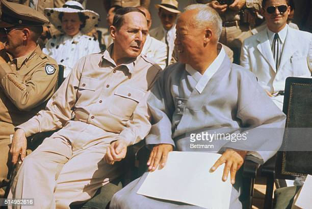 General Douglas MacArthur and Dr Syngman Rhee 1st president of the Republic of Korea sit together during a celebration marking the birth of this...
