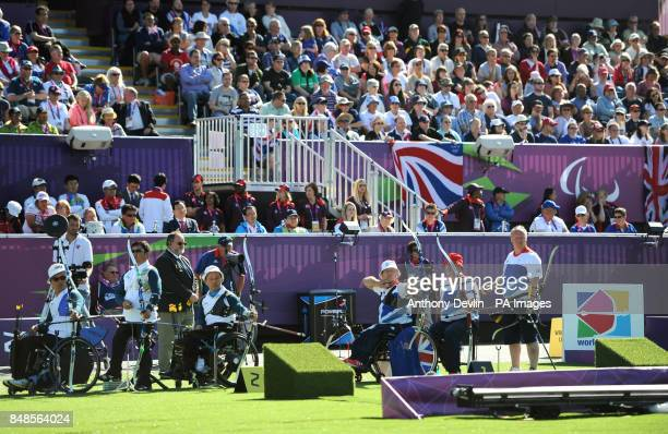 Republic of Korea's MyeongGu Lee Suk Ho Kim and Young Joo Jung compete against Great Britain's Paul Browne Phil Bottomley and Kenny Allen during the...