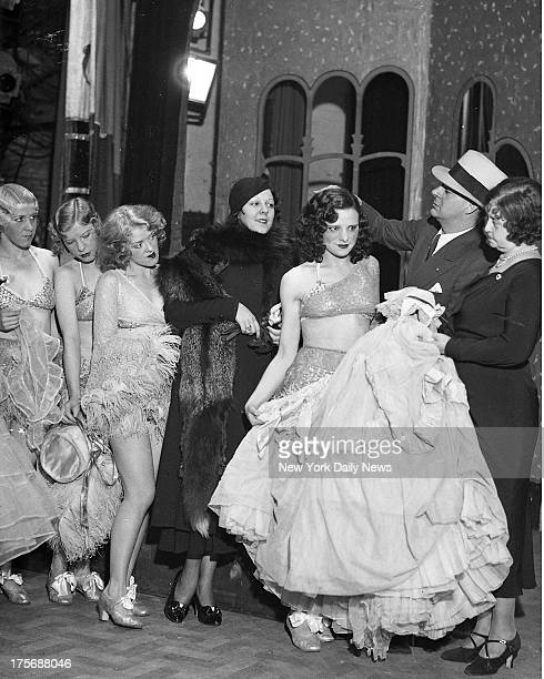 Republic Theatre girls get their outfits for the revived burlesque there Mrs Mary Alston is handing out costumes as Director Grove Frankie looks on...