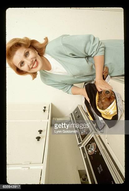 Republican activist Georgette Mosbacher dries off her dog on top of a washing machine Mosbacher is the author of Feminine Force Release the Power...