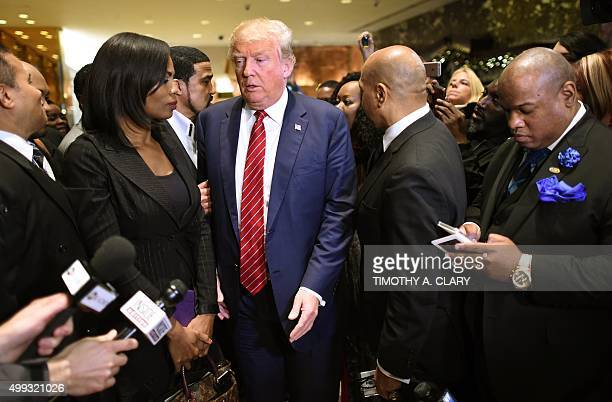 Republican Candidate Donald Trump arrives to speak to the press after meeting with African American pastors at Trump Tower in New York November 30...