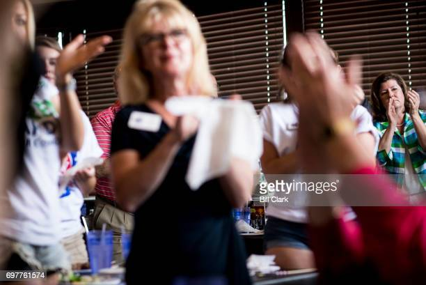 Republican candidate for Georgia's 6th Congressional district Karen Handel claps during a rally with supporters at the Cherokee Cattle Ranch...