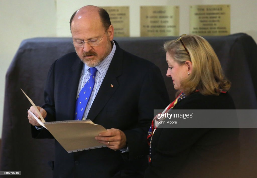 Republican candidate for New York City mayor <a gi-track='captionPersonalityLinkClicked' href=/galleries/search?phrase=Joe+Lhota&family=editorial&specificpeople=10110154 ng-click='$event.stopPropagation()'>Joe Lhota</a>, standing with his wife Tamra Roberts Lhota, studies his completed ballot before casting his vote on November 5, 2013 in the Brooklyn borough of New York City. New Yorkers went to the polls to choose between Lhota and Democratic candidate Bill de Blasio, widely considered the favorite going into election day.