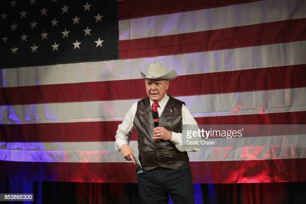 Republican candidate for the US Senate in Alabama Roy Moore displays a pistol to express his support for Second Amendment as he speaks at a campaign...