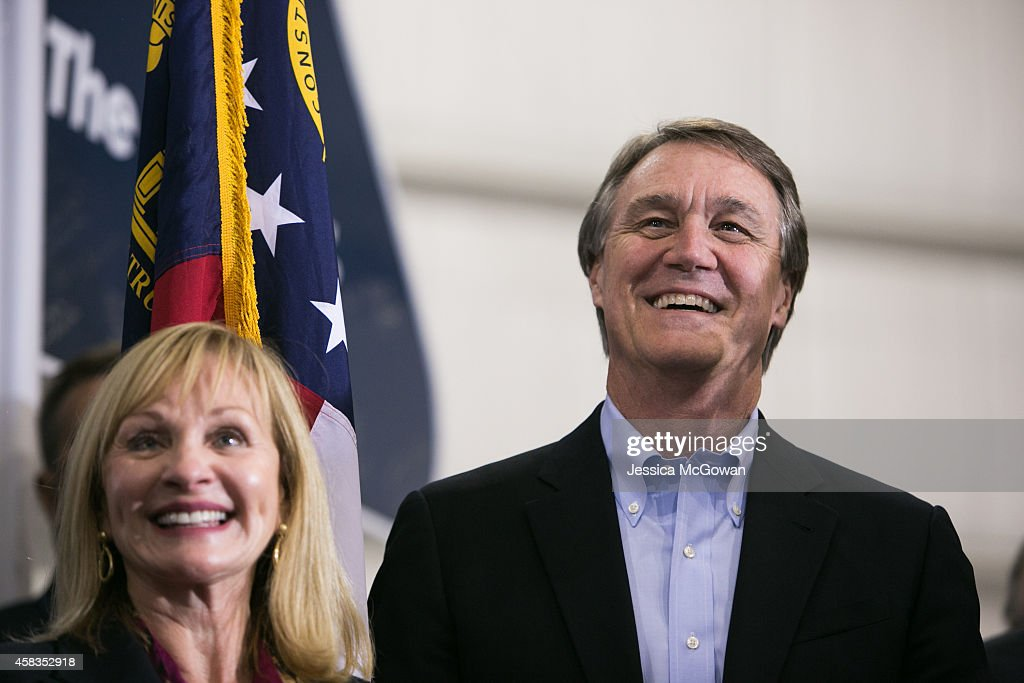Republican candidate for U.S. Senate <a gi-track='captionPersonalityLinkClicked' href=/galleries/search?phrase=David+Perdue&family=editorial&specificpeople=4276858 ng-click='$event.stopPropagation()'>David Perdue</a> (R) arrives at a campaign stop with wife, Bonnie, one day before the mid-term elections at Peachtree Dekalb Airport on November 3, 2014 in Atlanta, Georgia. Perdue is in a tight race with Democratic challenger Michelle Nunn.