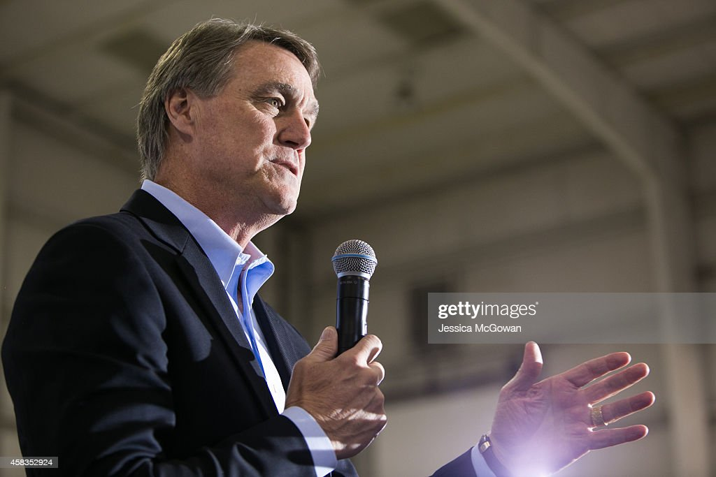 Republican candidate for U.S. Senate <a gi-track='captionPersonalityLinkClicked' href=/galleries/search?phrase=David+Perdue&family=editorial&specificpeople=4276858 ng-click='$event.stopPropagation()'>David Perdue</a> (R) speaks at a campaign stop one day before the mid-term elections at Peachtree Dekalb Airport on November 3, 2014 in Atlanta, Georgia. Perdue is in a tight race with Democratic challenger Michelle Nunn.