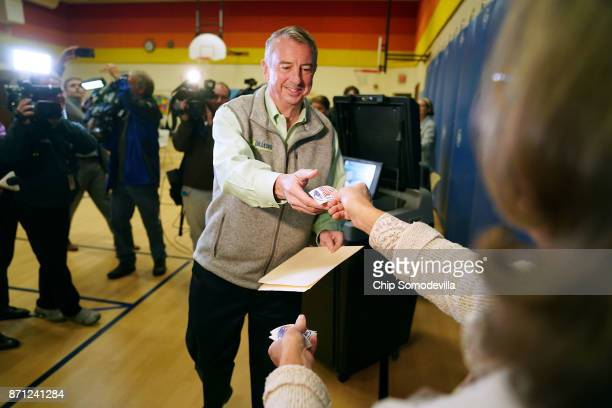 Republican candidate for Virginia governor Ed Gillespie gets an 'I Voted' sticker after casting his vote in the gymnasium at Washington Mill...