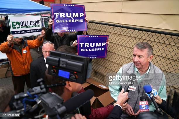 Republican candidate for Virginia governor Ed Gillespie talks to journalists after casting his vote at the polling place at Washington Mill...
