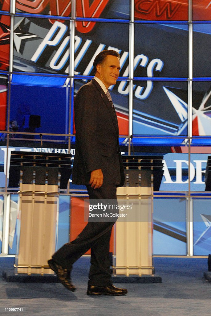 Republican candidate former Governor <a gi-track='captionPersonalityLinkClicked' href=/galleries/search?phrase=Mitt+Romney&family=editorial&specificpeople=207106 ng-click='$event.stopPropagation()'>Mitt Romney</a> (MA) enters the debate hall June 13, 2011 at Saint Anselm College in Manchester, New Hampshire. This is the first debate for the GOP contenders in the 'First in the Nation' primary state of New Hampshire.