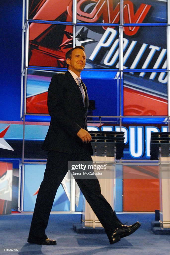 Republican candidate former Governor <a gi-track='captionPersonalityLinkClicked' href=/galleries/search?phrase=Tim+Pawlenty&family=editorial&specificpeople=2151047 ng-click='$event.stopPropagation()'>Tim Pawlenty</a> (MN) enters the debate hall June 13, 2011 at Saint Anselm College in Manchester, New Hampshire. This is the first debate for the GOP contenders in the 'First in the Nation' primary state of New Hampshire.