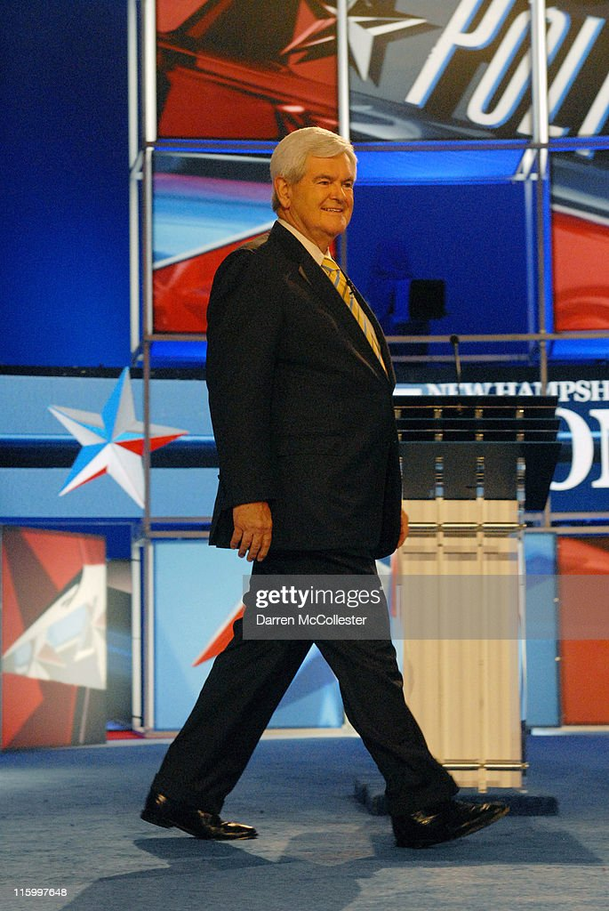 Republican candidate former Speaker of the House <a gi-track='captionPersonalityLinkClicked' href=/galleries/search?phrase=Newt+Gingrich&family=editorial&specificpeople=202915 ng-click='$event.stopPropagation()'>Newt Gingrich</a> enters the debate hall June 13, 2011 at Saint Anselm College in Manchester, New Hampshire. This is the first debate for the GOP contenders in the 'First in the Nation' primary state of New Hampshire.