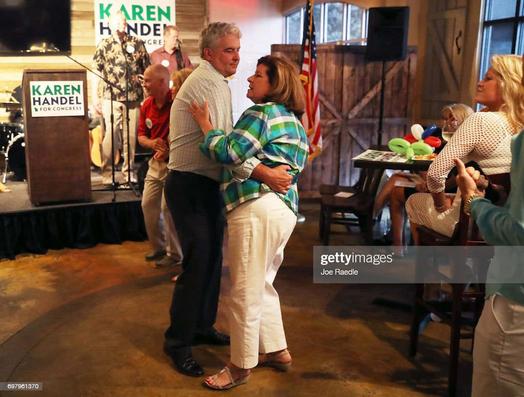 Republican candidate Karen Handel dances with her husband Steve Handel during a campaign stop at Houck's Grille as she runs for Georgia's 6th Congressional District on June 19, 2017 in Roswell, Georgia. Handel is running in a special election against the Democratic challenger Jon Ossoff to replace Tom Price, who is now the Secretary of Health and Human Services. The election will fill a congressional seat that has been held by a Republican since the 1970s.