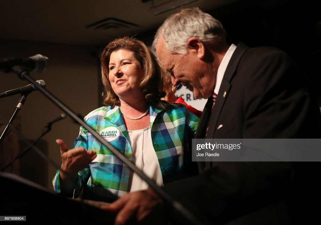 Republican candidate Karen Handel stands with Georgia Governor Nathan Deal as he introduces her to speak during a campaign stop at Houck's Grille as she runs for Georgia's 6th Congressional District on June 19, 2017 in Roswell, Georgia. Handel is running in a special election against the Democratic challenger Jon Ossoff to replace Tom Price, who is now the Secretary of Health and Human Services. The election will fill a congressional seat that has been held by a Republican since the 1970s.