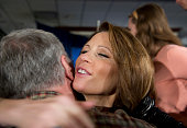 Republican candidate Michele Bachmann hugs a well wishers after announcing that she's pulling out of the campaign for US president the day after...