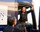 Republican candidate Michele Bachmann waves from her bus after announcing that she's pulling out of the campaign for US president the day after...