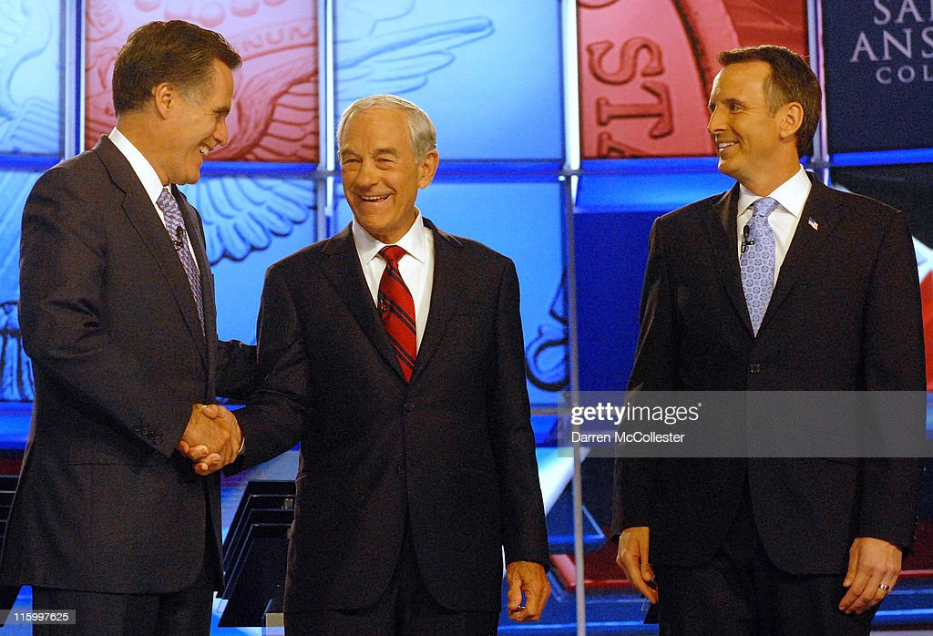 Republican candidates (L to R) former Governor <a gi-track='captionPersonalityLinkClicked' href=/galleries/search?phrase=Mitt+Romney&family=editorial&specificpeople=207106 ng-click='$event.stopPropagation()'>Mitt Romney</a> (MA) shakes hands with U.S. Rep. <a gi-track='captionPersonalityLinkClicked' href=/galleries/search?phrase=Ron+Paul&family=editorial&specificpeople=2300665 ng-click='$event.stopPropagation()'>Ron Paul</a> (TX) as former Governor <a gi-track='captionPersonalityLinkClicked' href=/galleries/search?phrase=Tim+Pawlenty&family=editorial&specificpeople=2151047 ng-click='$event.stopPropagation()'>Tim Pawlenty</a> (MN) looks on before their debate June 13, 2011 at Saint Anselm College in Manchester, New Hampshire. This is the first debate for the GOP contenders in the 'First in the Nation' primary state of New Hampshire.