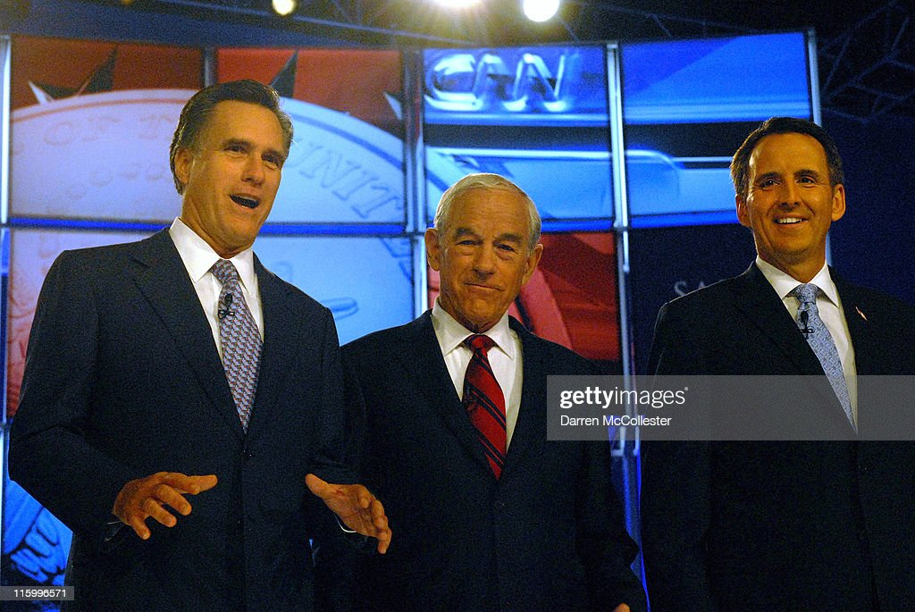 Republican candidates (L to R) former Governor Mitt Romney (MA), U.S. Rep. Ron Paul (TX) and former Governor Tim Pawlenty (MN) prepare for their debate June 13, 2011 at Saint Anselm College in Manchester, New Hampshire. This is the first debate for the GOP contenders in the 'First in the Nation' primary state of New Hampshire.