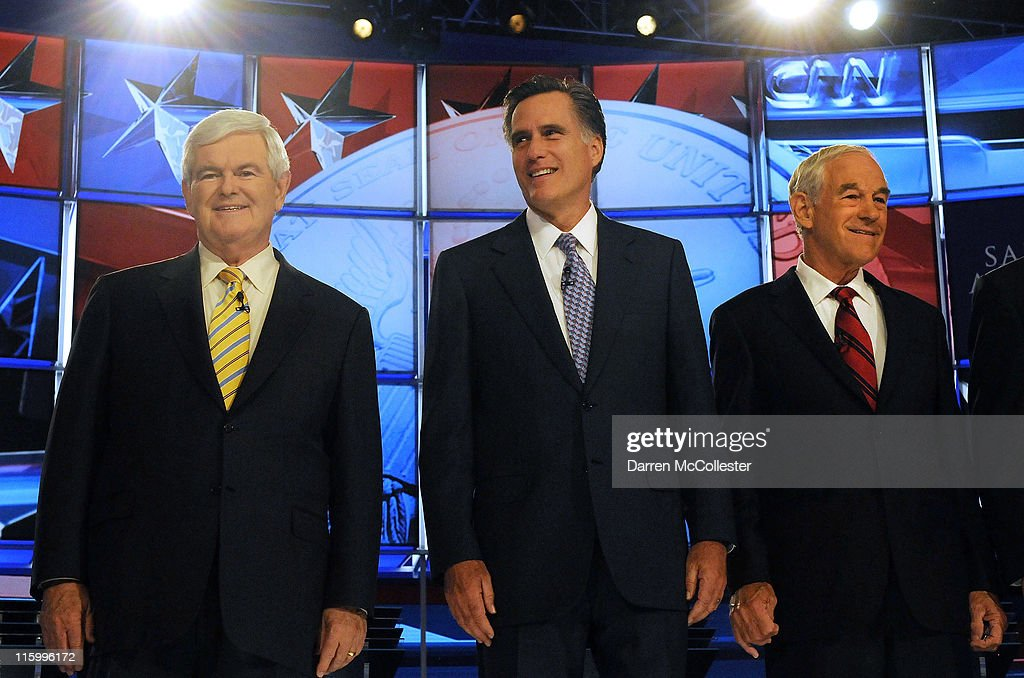 Republican candidates (L to R) former House Speaker <a gi-track='captionPersonalityLinkClicked' href=/galleries/search?phrase=Newt+Gingrich&family=editorial&specificpeople=202915 ng-click='$event.stopPropagation()'>Newt Gingrich</a>, former Governor <a gi-track='captionPersonalityLinkClicked' href=/galleries/search?phrase=Mitt+Romney&family=editorial&specificpeople=207106 ng-click='$event.stopPropagation()'>Mitt Romney</a> (MA) and U.S. Rep. <a gi-track='captionPersonalityLinkClicked' href=/galleries/search?phrase=Ron+Paul&family=editorial&specificpeople=2300665 ng-click='$event.stopPropagation()'>Ron Paul</a> (TX) prepare for their debate June 13, 2011 at Saint Anselm College in Manchester, New Hampshire. This is the first debate for the GOP contenders in the 'First in the Nation' primary state of New Hampshire.