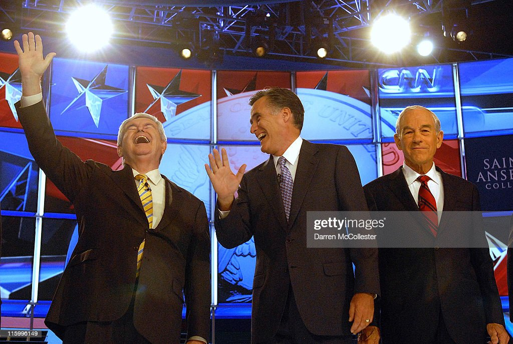 Republican candidates (L to R) former House Speaker <a gi-track='captionPersonalityLinkClicked' href=/galleries/search?phrase=Newt+Gingrich&family=editorial&specificpeople=202915 ng-click='$event.stopPropagation()'>Newt Gingrich</a> laughs along with former Governor <a gi-track='captionPersonalityLinkClicked' href=/galleries/search?phrase=Mitt+Romney&family=editorial&specificpeople=207106 ng-click='$event.stopPropagation()'>Mitt Romney</a> (MA) and U.S. Rep. <a gi-track='captionPersonalityLinkClicked' href=/galleries/search?phrase=Ron+Paul&family=editorial&specificpeople=2300665 ng-click='$event.stopPropagation()'>Ron Paul</a> (TX) prior to their debate June 13, 2011 at Saint Anselm College in Manchester, New Hampshire. This is the first debate for the GOP contenders in the 'First in the Nation' primary state of New Hampshire.