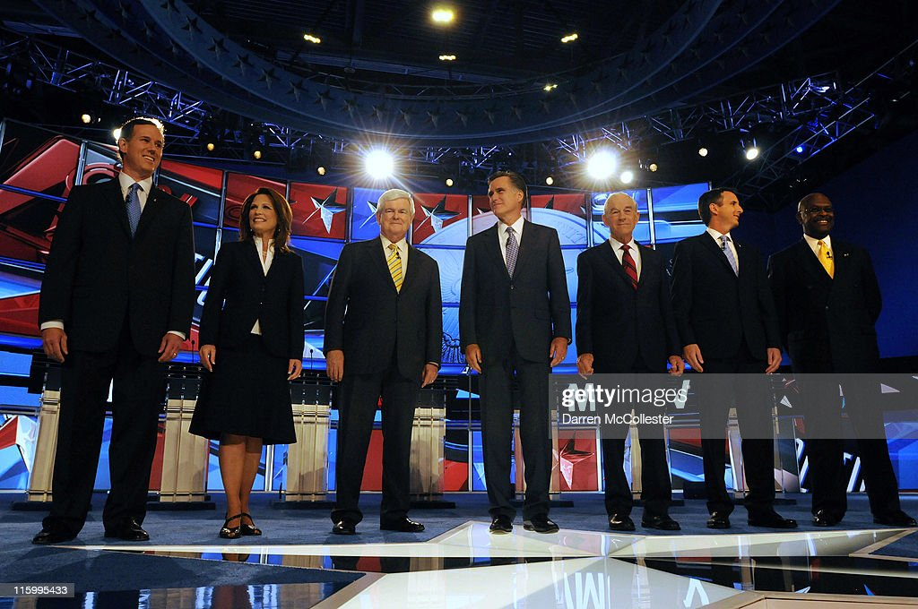 Republican candidates (L to R) former U.S. Sen. Rick Santorum (PA), U.S. Rep. Michele Bachmann (MN), former House Speaker Newt Gingrich, former Governor Mitt Romney (MA), U.S. Rep. Ron Paul (TX), former Governor Tim Pawlenty (MN), and businessman Herman Cain prepare for their debate June 13, 2011 at Saint Anselm College in Manchester, New Hampshire. This is the first debate for the GOP contenders in the 'First in the Nation' primary state of New Hampshire.